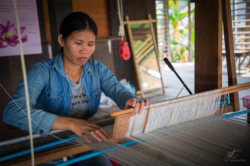 Hand weaving lotus fibers by hand