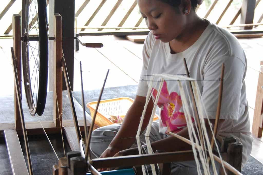 Worker threading lotus fibers